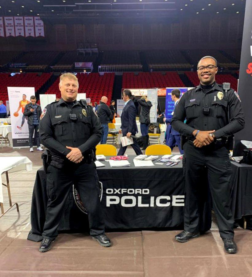 Officers Pete Durkin and Anthony Jones worked the Oxford Police Department table at Miami's Spring Career and Internship Fair on Wednesday in Millett Hall. The police department was one of a handful of local employers among the 250 at the fair. OPD has two open positions for police officers at the moment according to its Facebook page. Photo by the Oxford Police Department.
