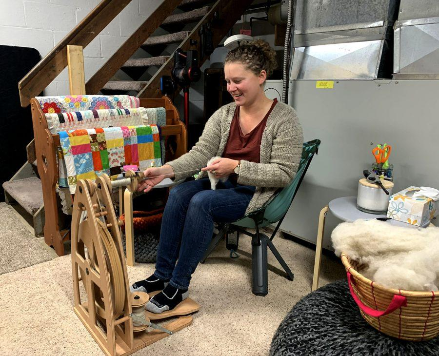 McQuigg+spinning+yarn+on+her+wheel.+A+largely+self-taught+%E2%80%9Cfiber+artist%2C%E2%80%9D+she+says+she+works+%E2%80%9Csheep+to+sweater.%E2%80%9D+%3Cem%3EPhoto+by+Lexi+Scherzinger%3C%2Fem%3E