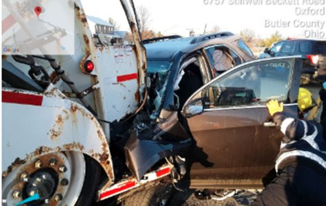 A College Corner woman died Wednesday when her SUV struck the rear of a Rumpke garbage truck that was stopped on Stillwell Beckett Road. <em>Photo provided by Oxford Township Police.</em>