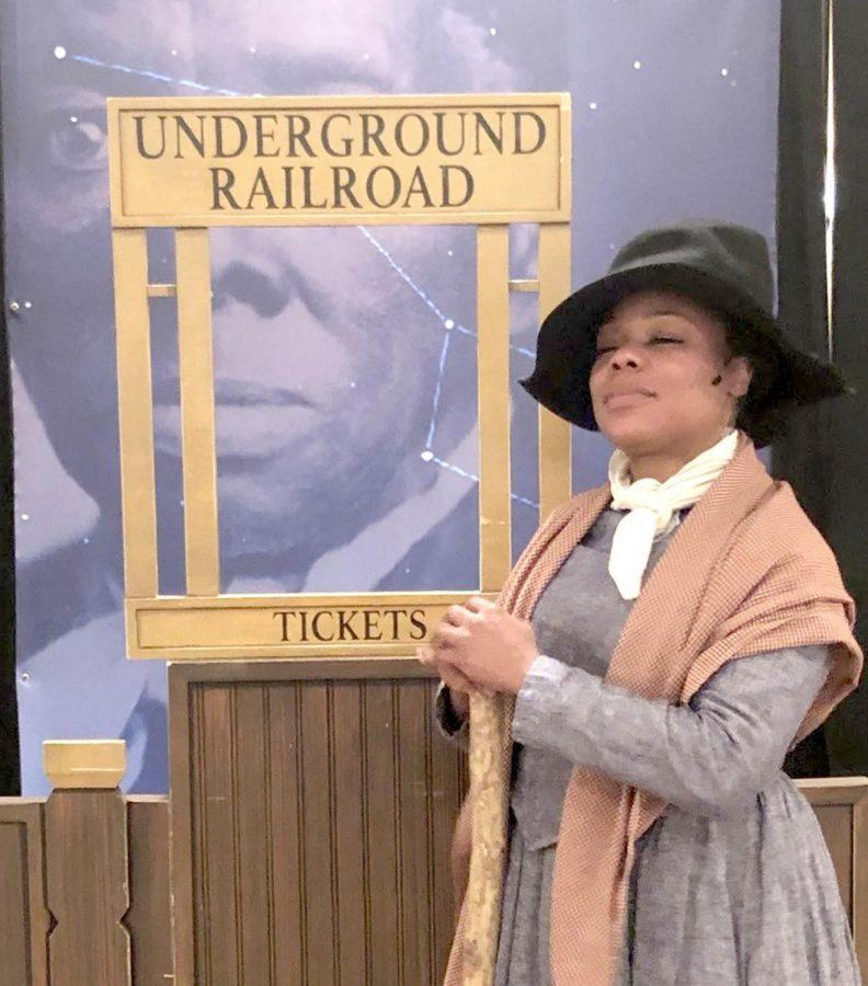 Brandi Sherrill, portraying Harriet Tubman in a one-woman show at the Oxford Community Art Center on Monday, interacting with the audience of children. Photo provided by Joseph Burtzlaff