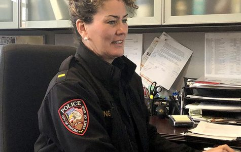 "Lt. Lara Fening of the Oxford Police Department types out the ""Weekend Update,"" an account of police activity every Monday. <em>Photo provided by Emma Kinghorn.</em><br>"
