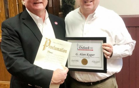 Alan Kyger (left) receives a proclamation from Oxford Mayor Mike Smith declaring March 5 Alan Kyger Day. Photo courtesy of the city of Oxford.<br>