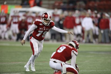 Sam Sloman lines up a field goal during a game this past season. <em>Photo from Miami Athletics</em><br>