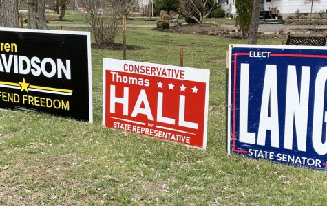 Pushing the Ohio Primary back to June 2 means campaign signs such as these, seen along U.S. 27 south of Oxford, will remain in view for a few more months.<em> Photo by David Wells</em>