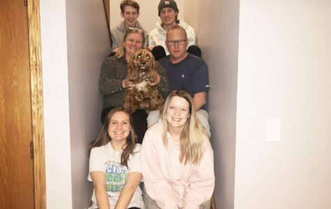 As many members of the Davis-Landgraf family as can, squeeze into a late-night quarantine photo on the stairs. <em>Photo by Jenna Landgraf</em>