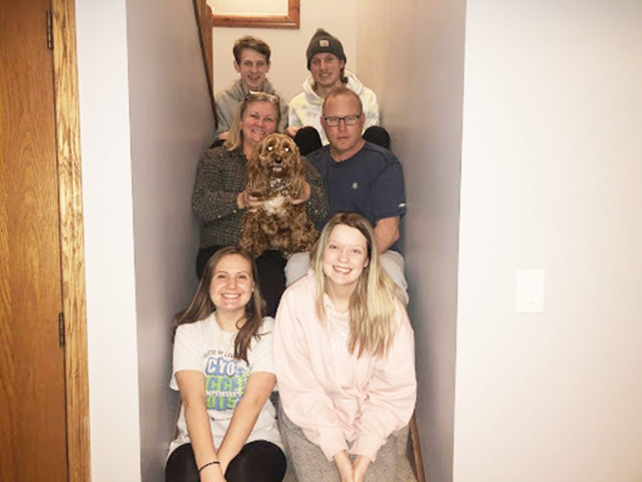 As many members of the Davis-Landgraf family as can, squeeze into a late-night quarantine photo on the stairs. Photo by Jenna Landgraf