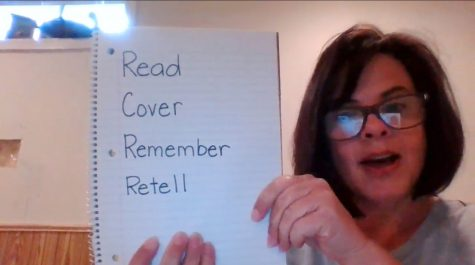 Teacher Robin Fakes reminds her students of some key words in a reading comprehension video she posted online. <em>Photo by Leah Fakes</em><br>