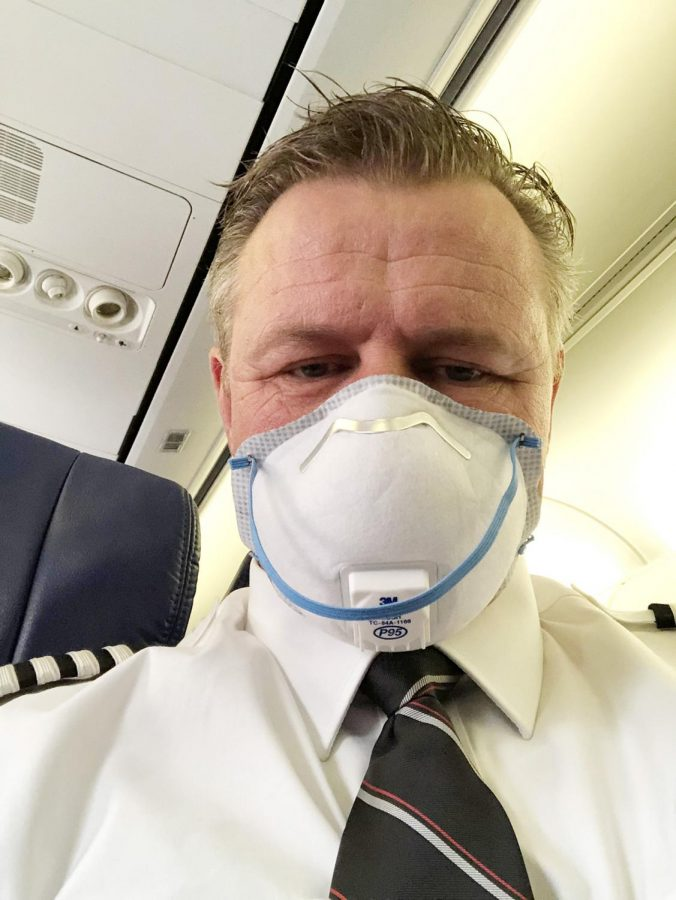 Capt.+Michael+Bonner+of+Southwest+Airlines%2C+wearing+a+mask+on+his+commuter+flight+to+Chicago%2C+where+he+will+take+over+as+pilot+on+an+aircraft.+%3Cem%3EPhoto+provided+by+Michael+Bonner+%3C%2Fem%3E