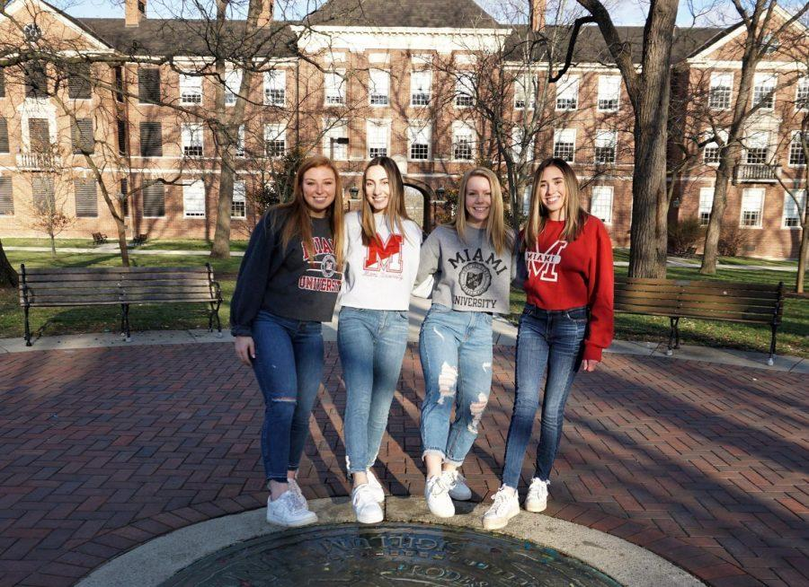 Four Miami roommates, whose senior year was cut short, pose for one last picture on the Miami seal. From left, Megan Remaley, Megan King, Sydney Shadovitz and Melissa Eterno. Photo provided by Megan Remaley