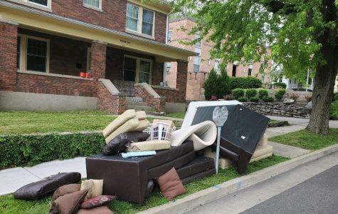 Rain-soaked couches and pillows litter the curb on South Campus Avenue. <em>Photo by Blake Boyd</em>