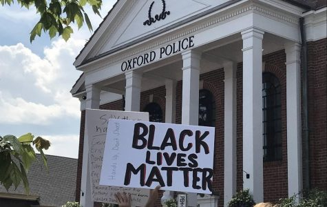 The march stopped first at the Oxford Police Station on High Street, where speakers addressed the crowd. <em>Photo by Patrick Keck</em><br>