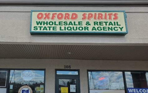 The owner of Oxford Spirits said business has been good, with increased foot traffic even with few students in town. <em>Photo by Blake Boyd</em>