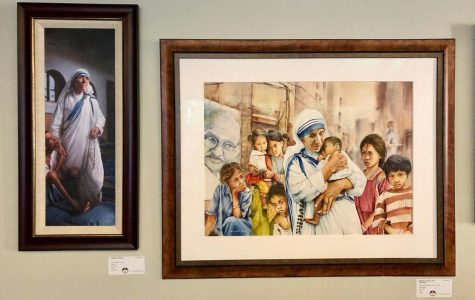 These paintings of Mother Teresa in the distinctive blue-bordered white habit of the Missionaries of Charity, are part of the display at the Interfaith Center. <em>Photo by Marla Chavez Garcia</em><br>