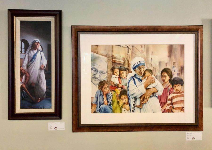 These paintings of Mother Teresa in the distinctive blue-bordered white habit of the Missionaries of Charity, are part of the display at the Interfaith Center. Photo by Marla Chavez Garcia
