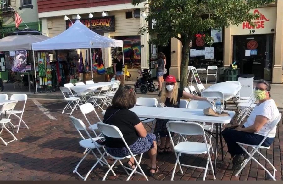Patrons at the Aug. 7 Red Brick Friday enjoy drinks and conversation at well-spaced outdoor tables.