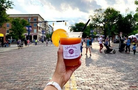 Adults are permitted to buy drinks in specially marked cups and stroll along a few blocks of High Street during the Friday events.