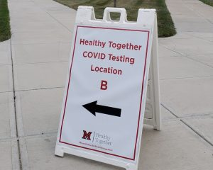 Sign in front of new university COVID testing center