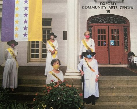 League of Women Voters members in period costume pose at the Oxford Community Arts Center