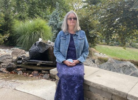 Caroline Lehman-Croswell, who has built the Oxford Community Arts Center into an integral and vibrant part of the city's life in her 14 years as executive director, reflects on her career in one of the center's many gardens.