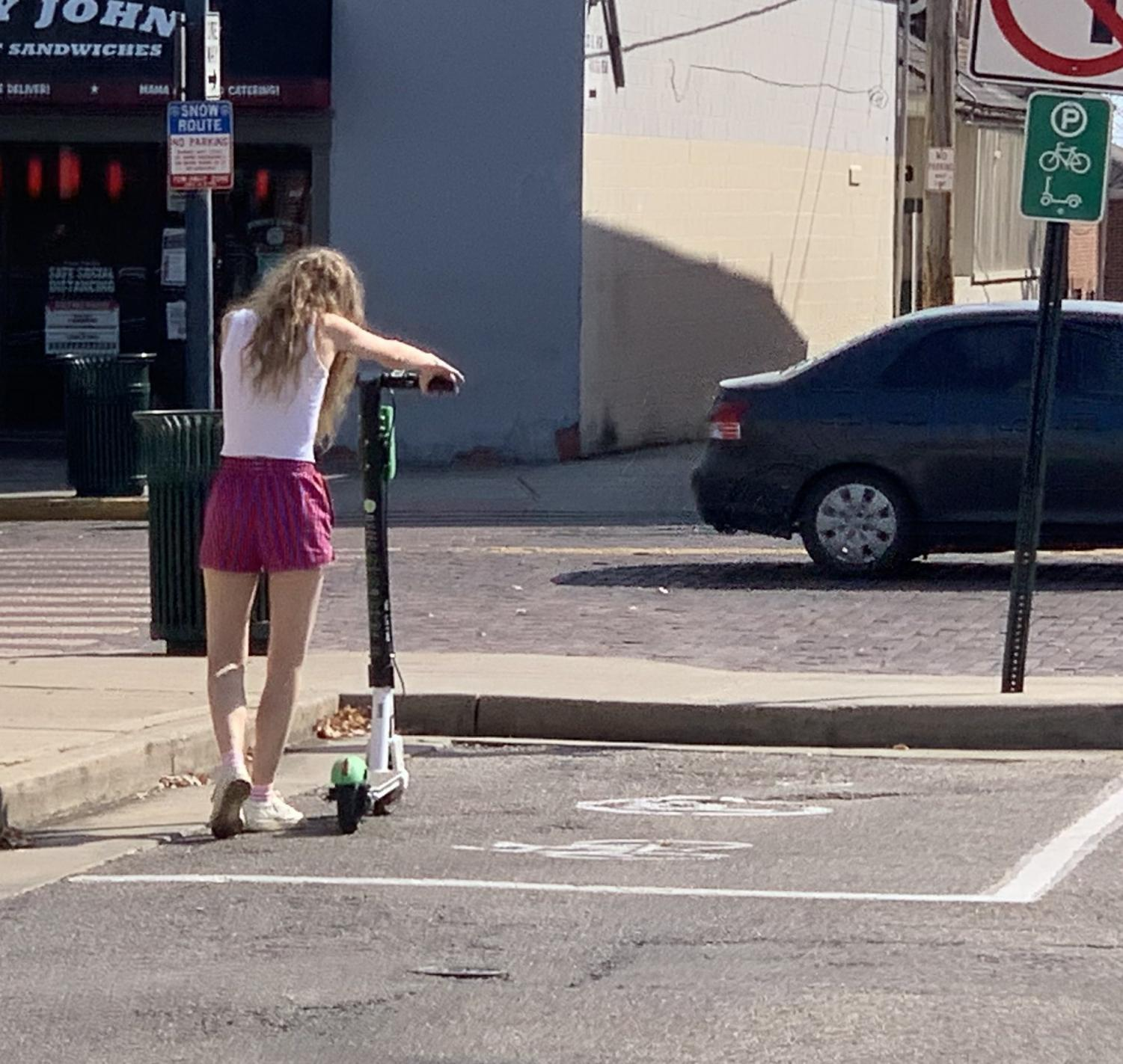 Students rent scooters from designated parking areas