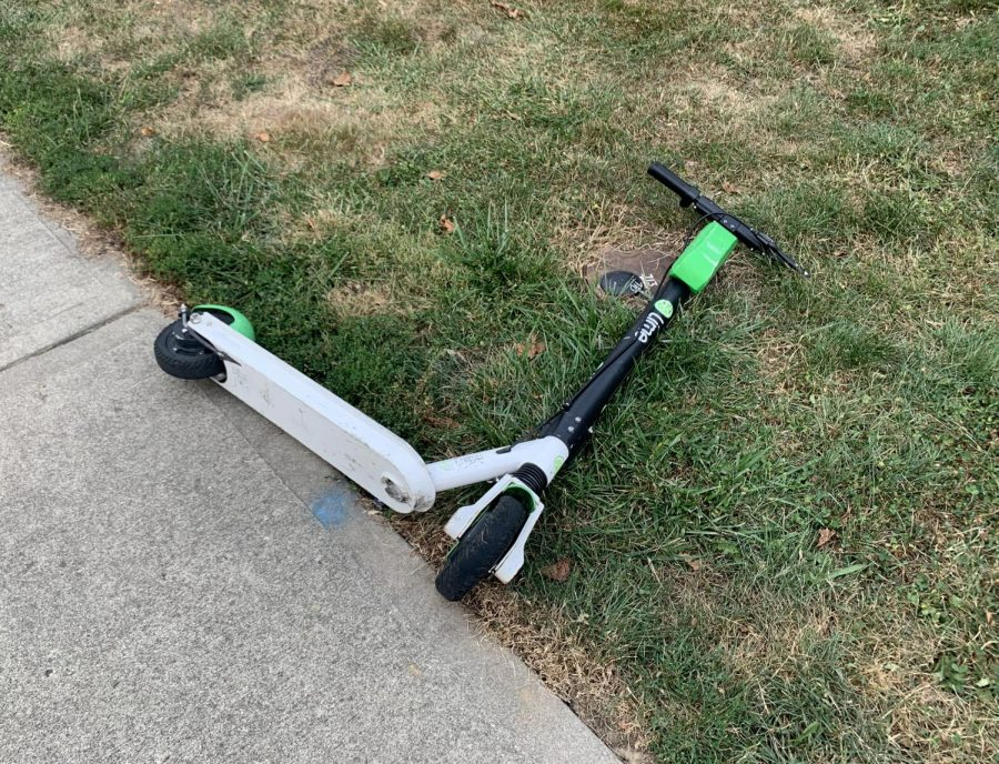 Lime scooter parked improperly on the sidewalk of Main Street