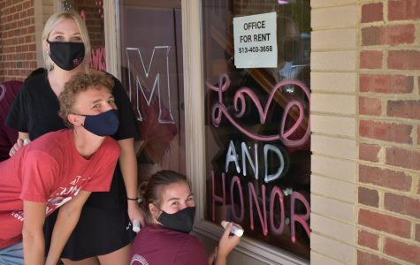Volunteers decorate Oxford with Miami spirit for virtual homecoming begining Oct. 9