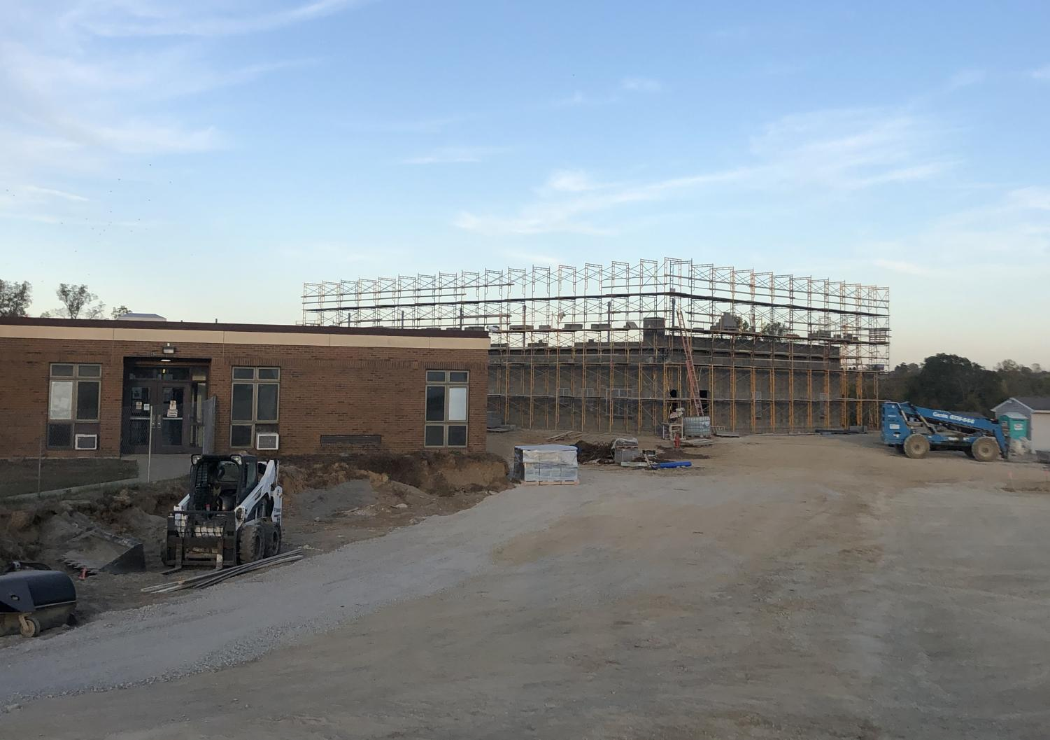 The new school is going up next to the old school, which is still in use
