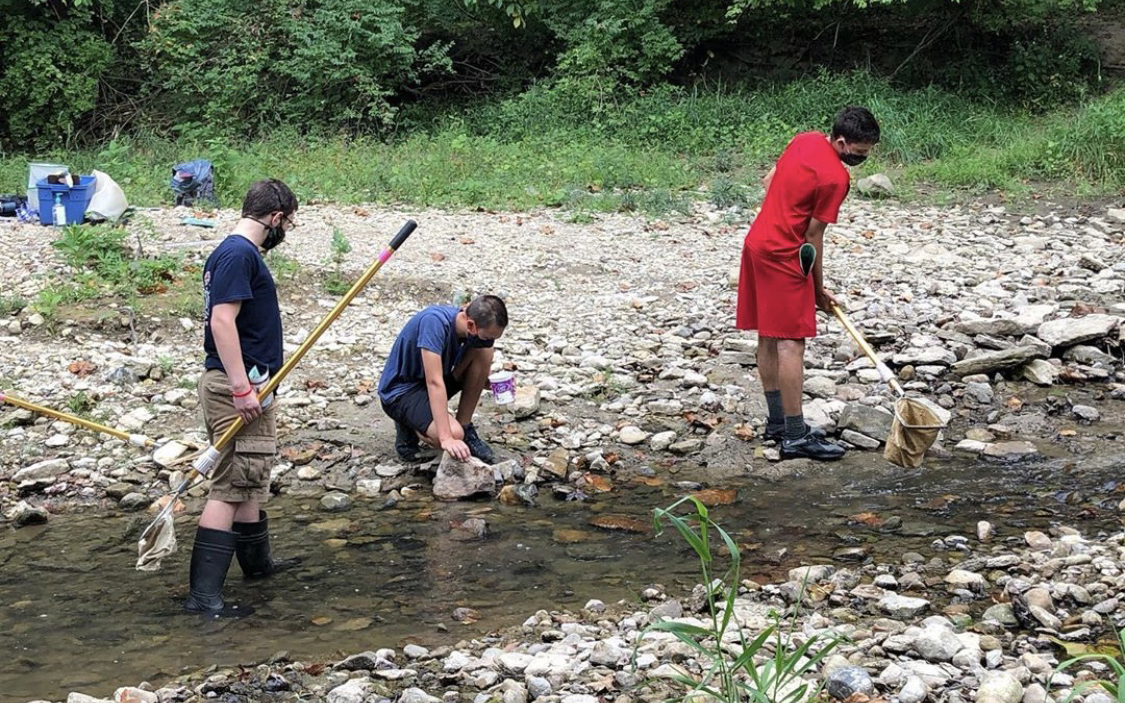 McGuffey Montessori high school students visit local watersheds to learn about runoff and stream health