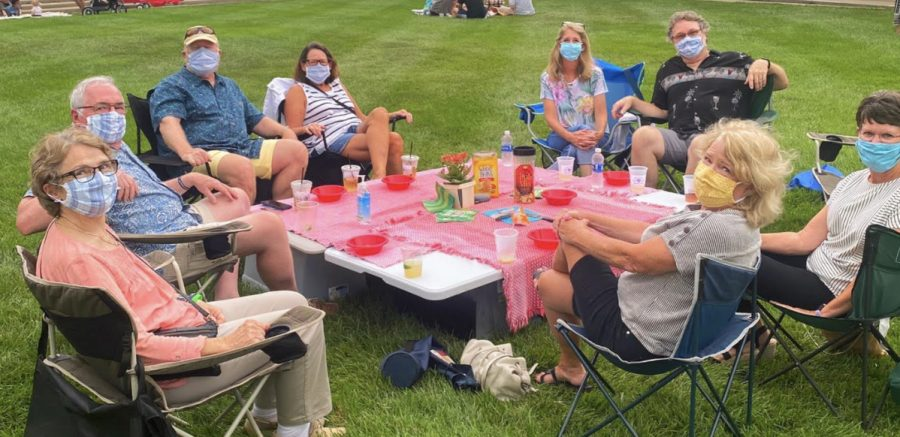 Oxford residents enjoy drinks and dining on the grass of Uptown Park