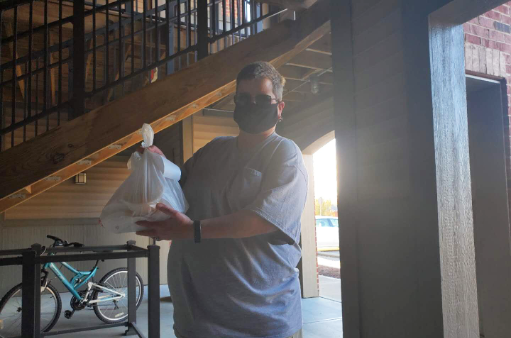 DoorDash driver drops off delivery for customer in Oxford.