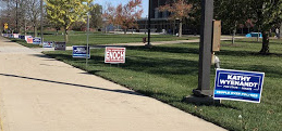 Signs outside of polling places remind voters to mask up and maintain a social distance during Tuesday's election.