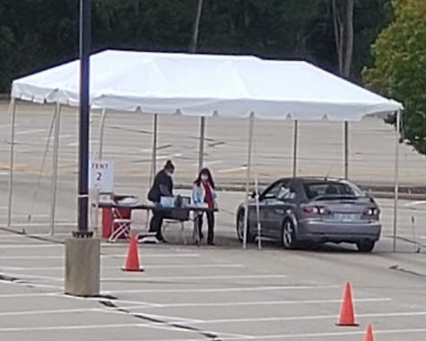 As shown in this photo from last fall, students living in dorms will be able to receive drive-thru testing in the Millett Hall parking lot during check-in next week.