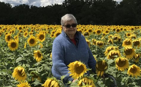 Ann Handforth McLellan in a field of sunflowers near Yellow Springs, Ohio.