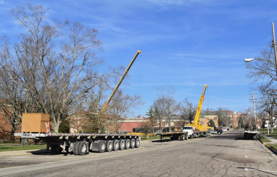 It takes a fleet of flatbed trucks lined up along Oak Street the haul the tower's remnants away for scrap.