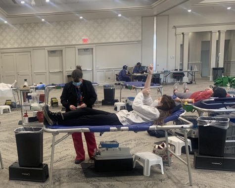 Donors stretch out on cots and give blood in Miami University's Shriver Center.