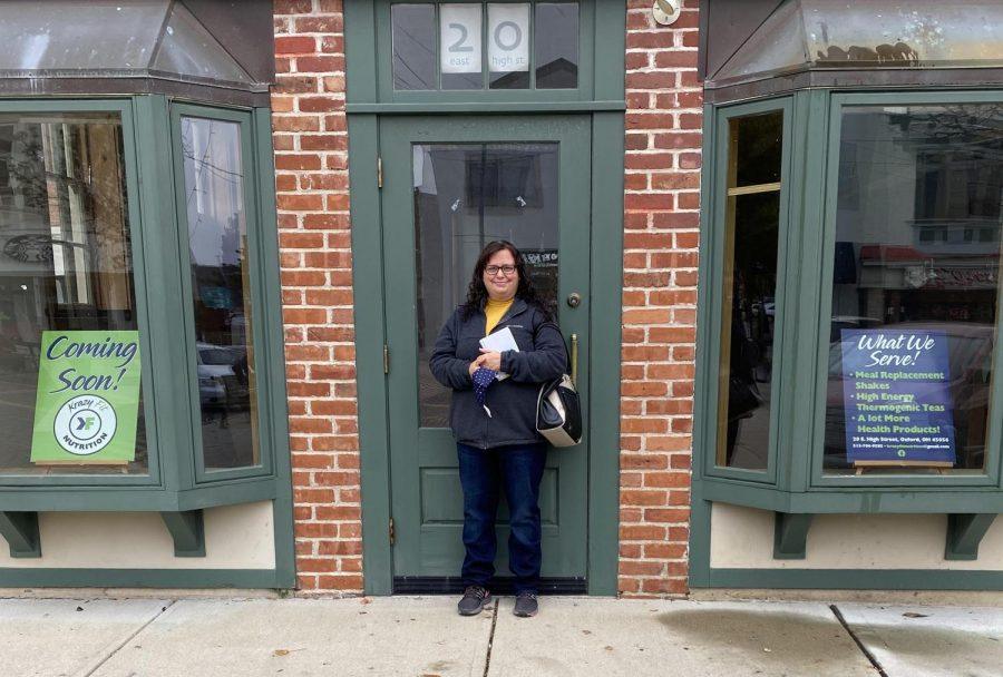 Jennifer Buckalew, owner of Krazy Fit Nutrition, stands in front of 20 East High Street, Krazy Fit Nutrition's soon to be a storefront.
