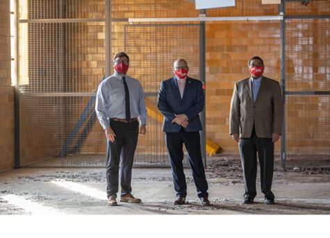 From left, Seth Cropenbaker, assistant to the Oxford city manager; Miami President Gregory Crawford and Randi Thomas, head of the university's ASPIRE office, check out the now-vacant building that will house the innovation hub at 20 S. Elm St.