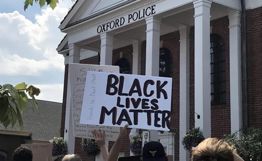 Protesters gather outside the Oxford Police Department during last September's Black Lives Matter demonstration.