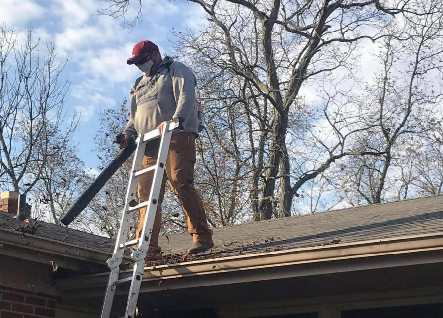 Andrew Swatzell, of Andyman Services, specializes in doing whatever is needed to solve his customer's maintenance and repair needs, including, in this case, cleaning out gutters.