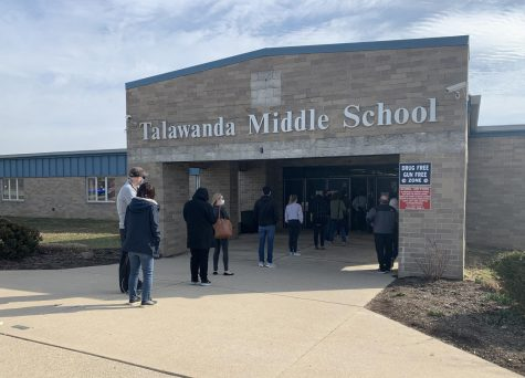 People line up to get their COVID-19 vaccinations outside of Talawanda Middle School, Wednesday afternoon.