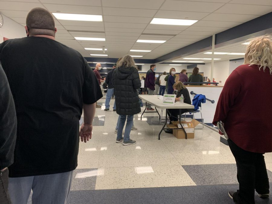 Masked and eager, people with appointments waited for COVID-9 vaccinations inside Talawanda Middle School on Wednesday.