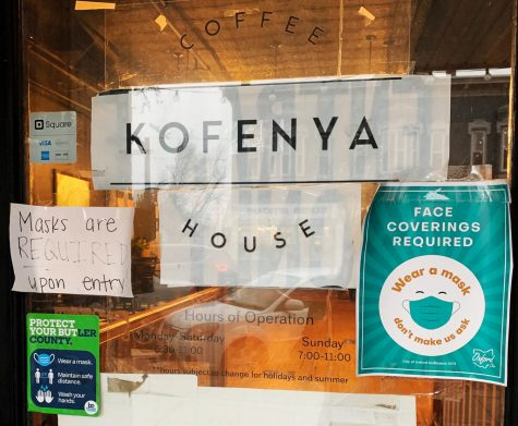 State and local regulations require masks to be worn inside all local business, as attested to by these signs in the window of the Kofenya Coffee House, 38 W. High Street.