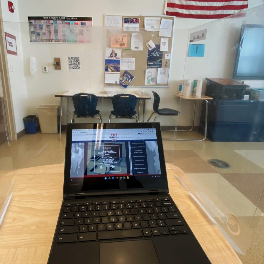 Families were given the choice of sending their children back to the classrooms in Talawanda Schools for spring semester. About 80% chose to have students study in school, where desks such as this one are surrounded by plastic shields. The other 20% attend classes virtually by signing into the district's remote learning program – as shown on the computer screen in this photo.