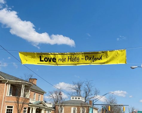 This Defending Democracy-sponsored banner flew uptown earlier this year in response to anti-Asian discrimination.