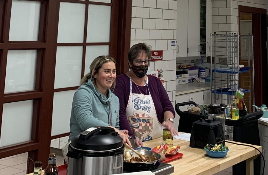 Nancy Parkinson (right) and Emily Kahn, junior dietetics and nutrition major and member of SAND, cook jackfruit BBQ while chatting with participants on Zoom.