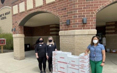 taff with books donated during the pandemic from the local UPS store.