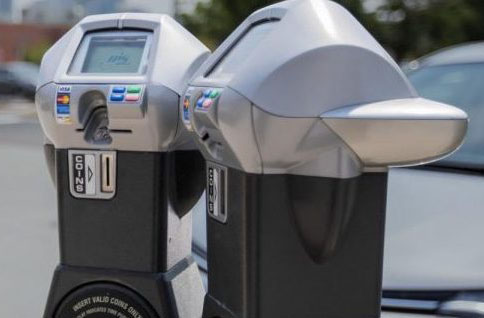 "The city is ordering 367 ""smart"" parking meters like these that can read credit cards and smart phone apps but will not accept coins."