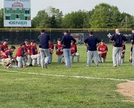 The varsity Brave team took a knee to hear from the coaches after losing to Harrison in the conference tournament.