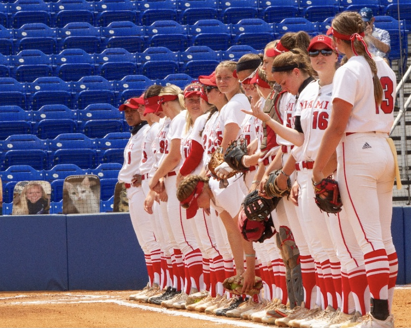 Miami softball team lines up for its game against Northwestern in the NCAA regionals.
