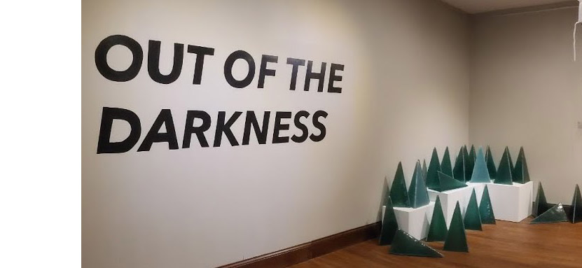 """In his COVID-19 inspired """"Out of Darkness"""" exhibition at Pyramid Hill Sculpture Park, Butler County artist Darryl Berry created three-sided green glass tetrahedrons, each representing 10 lives lost to COVID."""